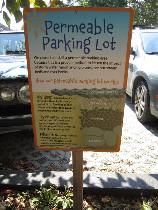 Permeable parking lots and community gardens abound
